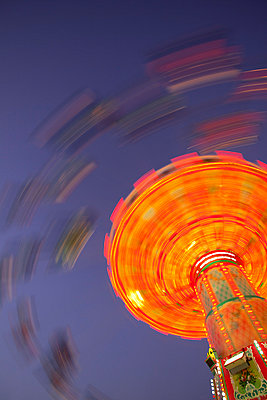 Carousel ride at night Oktoberfest funfair - p609m1017601 by WRIGHT