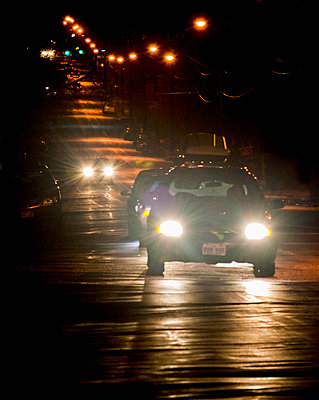 Oncoming Traffic at Night - p555m1453065 by Spaces Images