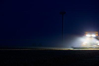 Corn harvest at night - p719m1445921 by Rudi Sebastian