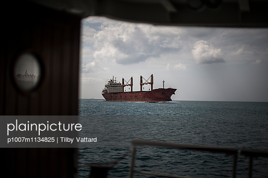 View from a Vapur boat deck on a container boat - p1007m1134825 by Tilby Vattard