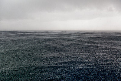 stormy clouds and heavy rain over the ocean - p1014m1197721 by Virginie Miramon