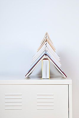 Books forming a fir tree - p238m1588917 by Anja Bäcker