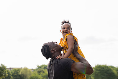 Father lifting up happy daughter - p300m2154840 by Francesco Buttitta