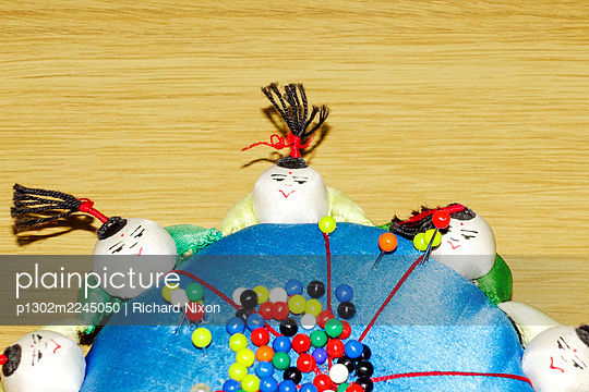 Blue pin cushion with multicoloured pins - p1302m2245050 by Richard Nixon