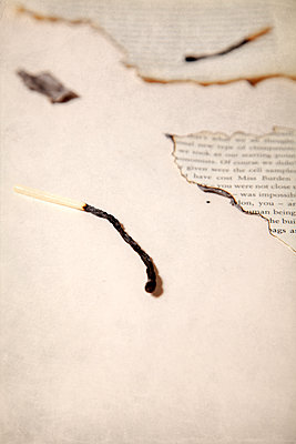 Burnt Book Pages with Match  - p1248m2087684 by miguel sobreira