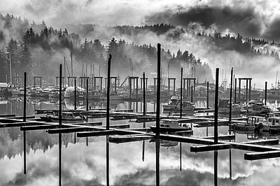 Black and white scenic of Auke Bay harbour on a foggy day, Southeast Alaska; Juneau, Alaska, United States of America - p442m2077654 by John Hyde