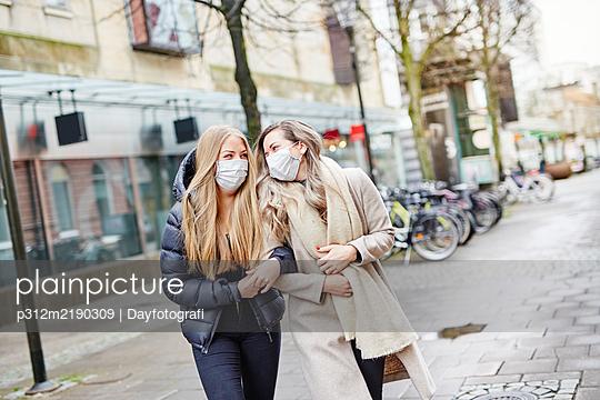Female friends having walk together - p312m2190309 by Dayfotografi