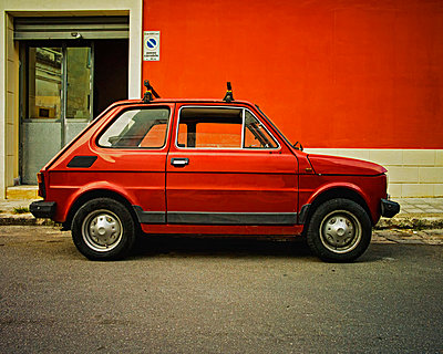 Italy, Old red fiat 500 on street of San cesario di Lecce - p300m878107 by Dirk Kittelberger