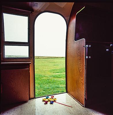 Open door of Airstream caravan - p1082m2228220 by Daniel Allan