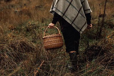 Woman carrying wicker basket - p312m2191023 by Jennifer Nilsson