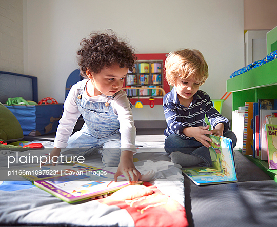 Children (2-3, 4-5) looking at books