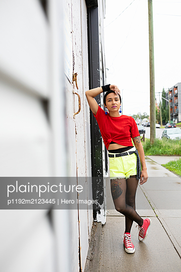 Portrait confident, cool young woman on urban sidewalk - p1192m2123445 by Hero Images