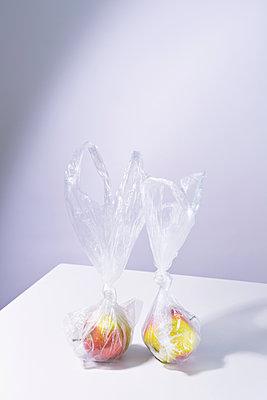 Apples in plastic bags - p1149m2122520 by Yvonne Röder