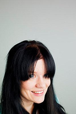 Woman looking at camera - p4130750 by Tuomas Marttila