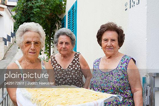 Older women with basket of pasta - p42917261f by Judith Haeusler