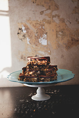 Chocolate cake with nuts on table - p352m1100364f by John Sandlund