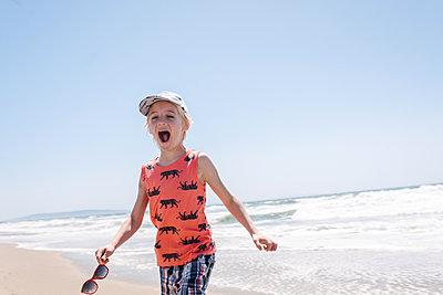 Boy by the sea, shouting - p924m2271144 by Viara Mileva