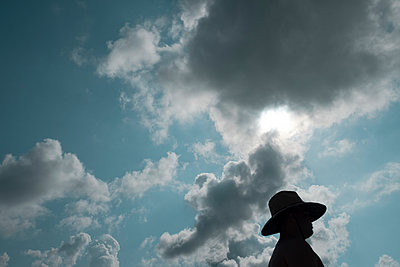 Sun Hat and Clouds - p1262m1584319 by Maryanne Gobble