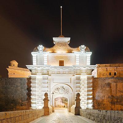 Mdina gate illuminated at night, Malta - p429m824417 by Alex Holland
