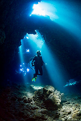 Diver inside a cavern known as First Cathedral off the island of Lanai; Hawaii, United States of America  - p442m1578805 by Dave Fleetham