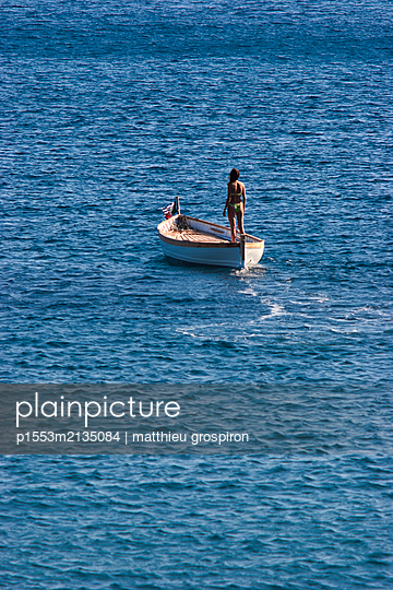 Woman on a boat - p1553m2135084 by matthieu grospiron