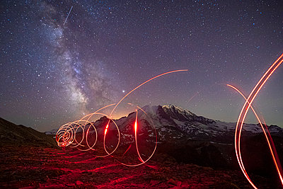 Stunning Milky Way Over Mt. Rainier and a Flashlight Track - p1166m2129859 by Cavan Images