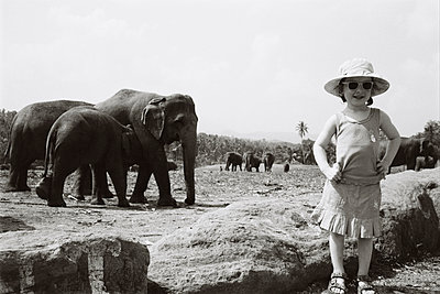 Girl and Elephants, Sri Lanka - p1215m1026316 by Kim Keibel