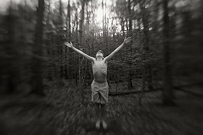 Boy in the Forest with Arms Up - p1503m2015881 by Deb Schwedhelm