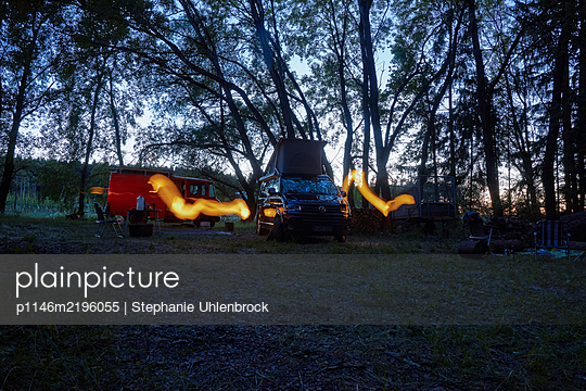 Mobile homes at twilight on the edge of woods - p1146m2196055 by Stephanie Uhlenbrock