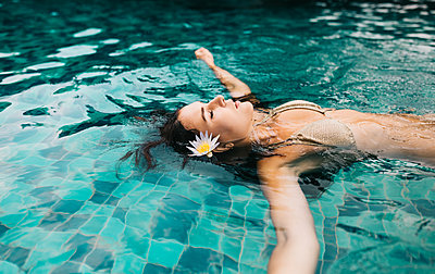 Beautiful Caucasian Woman Swimming in the pool - p1417m2158375 by Jessica Lia