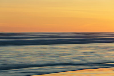 View from the beach over the ocean at sunset, long exposure - p1100m1216312 by Mint Images