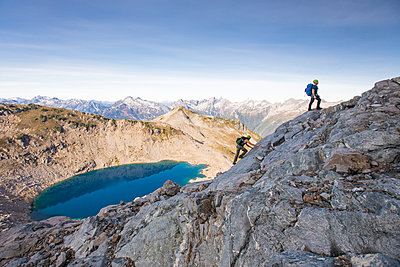 Climbers ascend a rocky ridge on Douglas Peak, B.C., Canada. - p1166m2095153 by Cavan Images