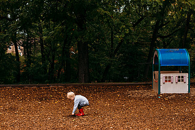 Toddler boy in the playground - p1238m1462497 by Amanda Voelker