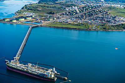 High angle view of oil transfer between oil refinery and oil tanker - p924m1030274f by Pete Saloutos