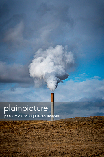 power plant Smokestack releasing pollution and steam - p1166m2078130 by Cavan Images