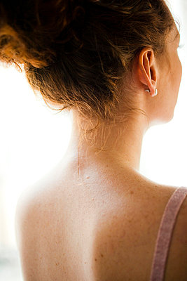 Neck of young woman - p4130562 by Tuomas Marttila