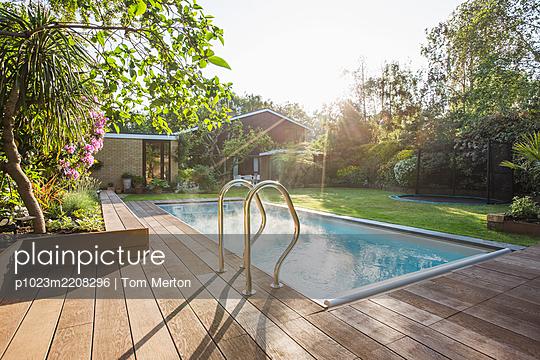 Sunny idyllic home showcase swimming pool and backyard - p1023m2208296 by Tom Merton