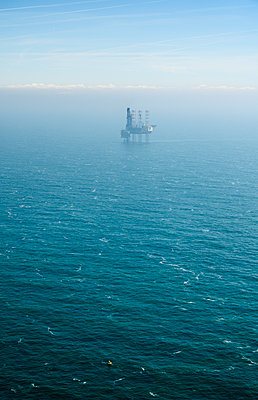 Oil drilling platform in the fog - p1132m2126202 by Mischa Keijser