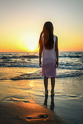 Child Looking out to Sea at Sunset  - p1019m1467947 by Stephen Carroll