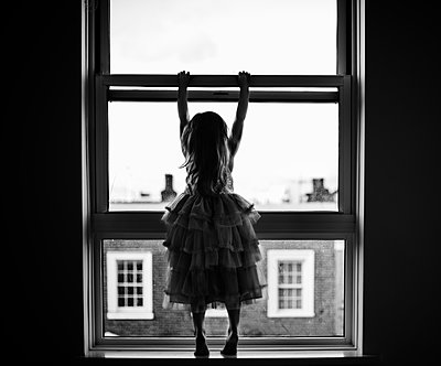 Girl Looking Out of the Window - p1459m1528476 by Zoe Space