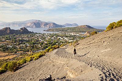 Aeolian Islands, Vulcano, female senior hiker at volcano - p300m2104321 by Maria Maar