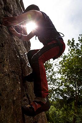 Boy rock-climbing - p1687m2295138 by Katja Kircher