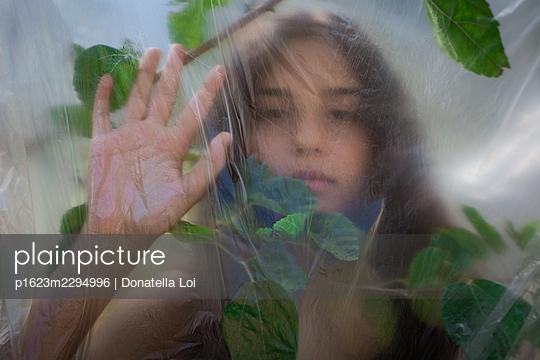 Girl under a plastic foil - p1623m2294996 by Donatella Loi
