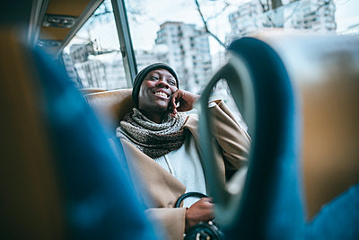 Smiling young woman traveling by bus - p300m1449440 by Kiko Jimenez
