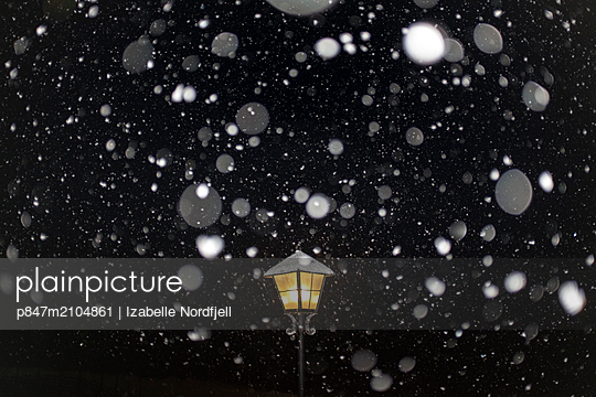 Illuminated Street Lamp In Snowy Weather   - p847m2104861 by Izabelle Nordfjell