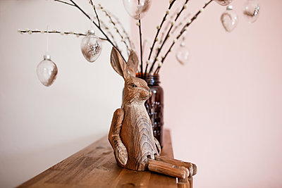 Wooden Easter bunny on a shalf - p300m2103954 by Katharina Mikhrin