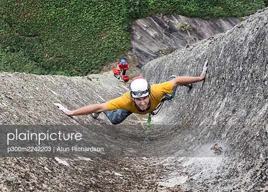Male rock climber challenging steep wall of Pedra Baiana - p300m2242203 by Alun Richardson