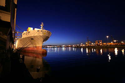 Freighter in port at night - p555m1301667 by Tom Paiva Photography