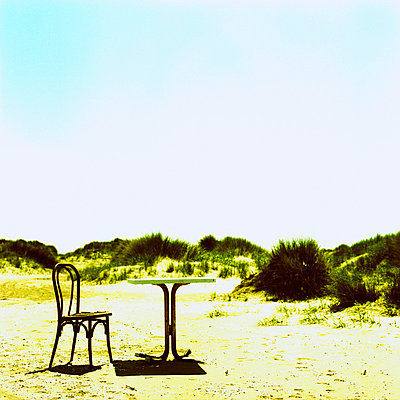 Chair and desk in on a beach - p7780053 by Denis Dalmasso