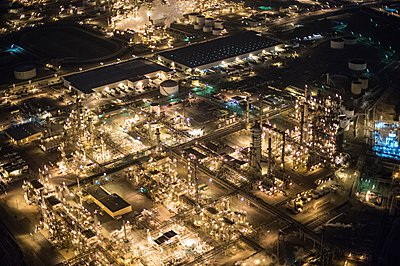 Aerial view of oil refinery illuminated at night, Los Angeles, California, USA - p924m1084955f by Pete Saloutos